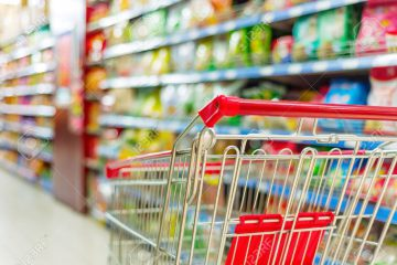 27250755-supermarket-interior-empty-red-shopping-cart-